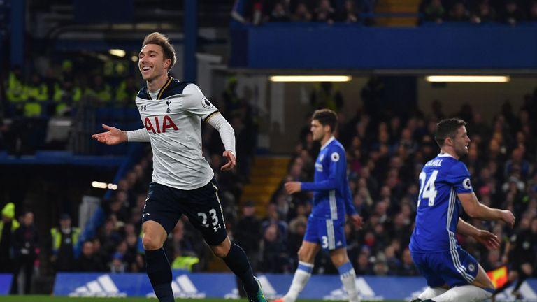 Tottenham Hotspur's midfielder Christian Eriksen (L) celebrates scoring the opening goal against Chelsea