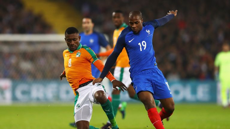 Ivory Coast forward Salomon Kalou (left) battles for the ball with France's Djibril Sidibe