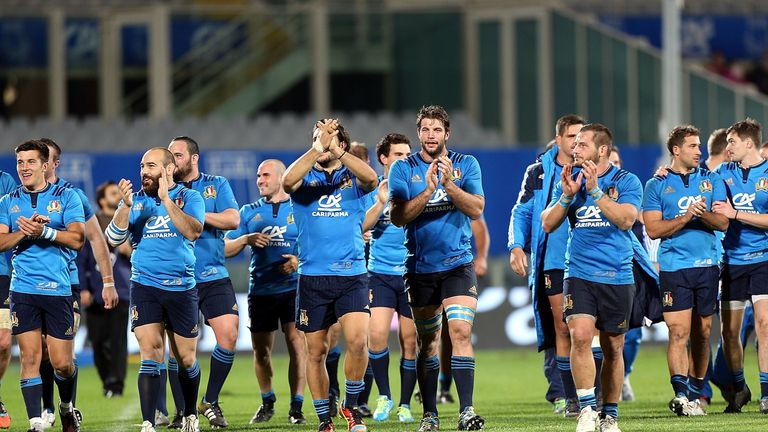 Italy celebrate their first ever victory over South Africa