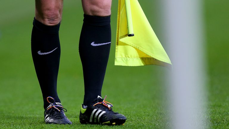 The assistant referee in the Leicester City v Middlesbrough gets involved with the rainbow laces