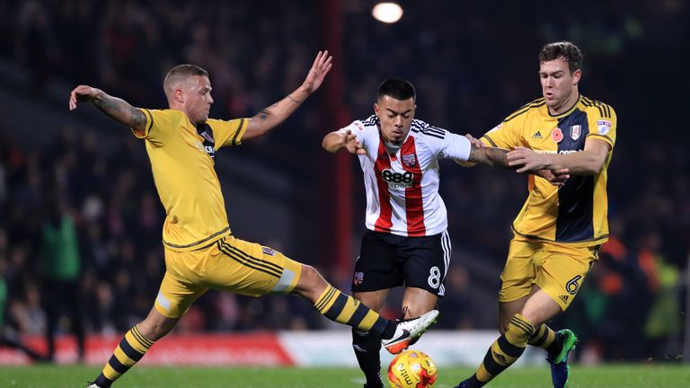 Nico Yennaris battles for possession of the ball with Fulham's Ragnar Sigurdsson (left) and Kevin McDonald