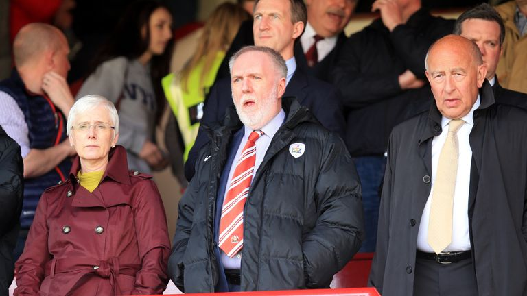 Barnsley owner Patrick Cryne (centre) says he does not expect to live until the end of the season