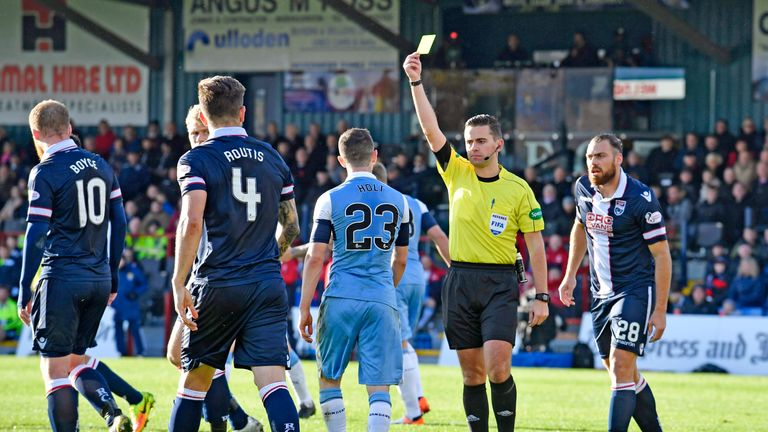 Rangers' Jason Holt is shown a yellow card for simulation during the game against Ross County