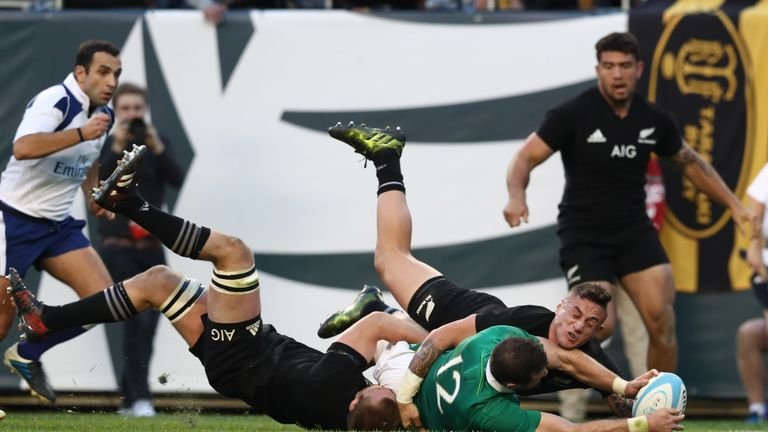 Robbie Henshaw of Ireland crashes over to score his team's fifth try