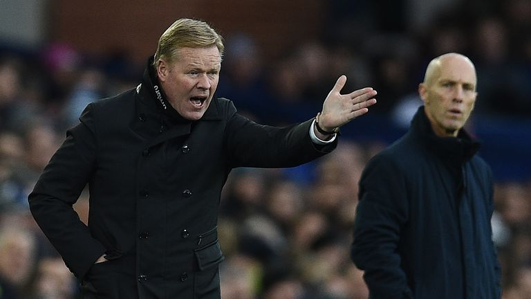 Everton manager Ronald Koeman (L) had to settle for a point at home