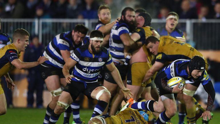 Bath's Jack Wilson evades the challenge of Bristol's Olly Robinson