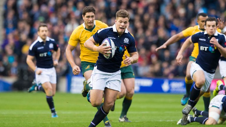 Huw Jones runs through to score his first of two tries