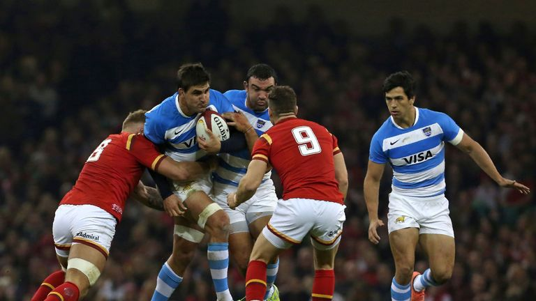 Pablo Matera is tackled by Wales No 8 Ross Moriarty (right)