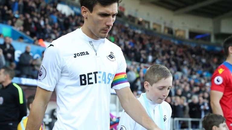 Swansea's Jack Cork also wore the rainbow armband