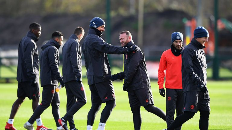 Ibrahimovic shares a joke with Wayne Rooney during training on Wednesday morning