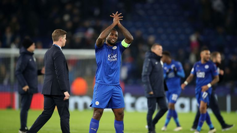 Wes Morgan celebrates their qualification at the King Power Stadium