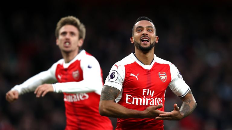 Theo Walcott celebrates putting Arsenal ahead in the second half
