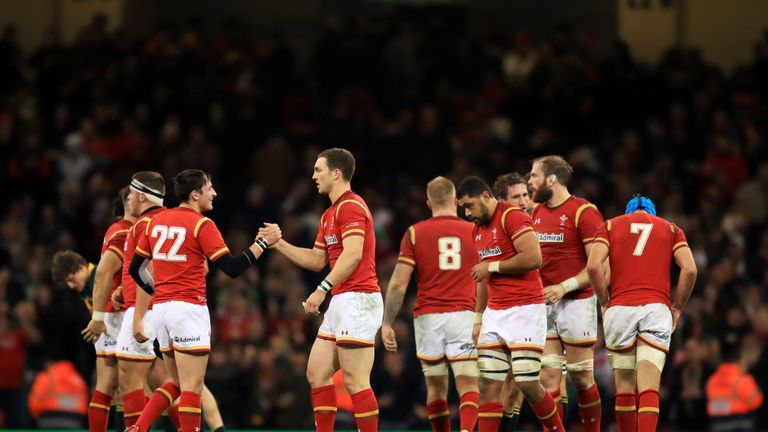 Wales players celebrate after beating  South Africa in Cardiff