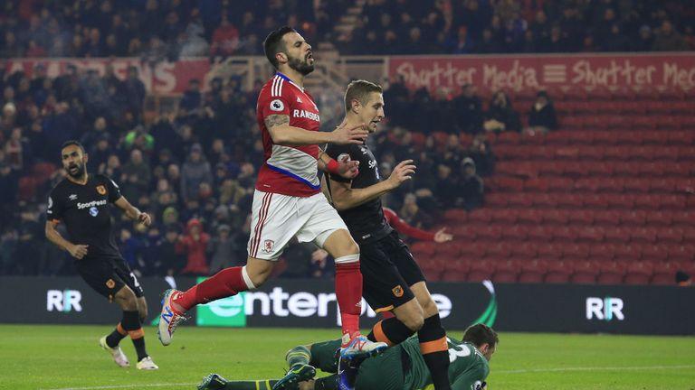 Hull goalkeeper David Marshall saves a shot from striker Alvaro Negredo