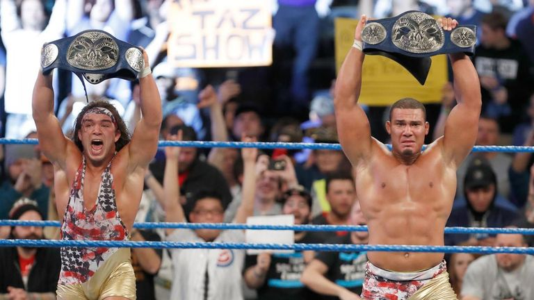 Gable and Jason Jordan hold their newly-won titles aloft