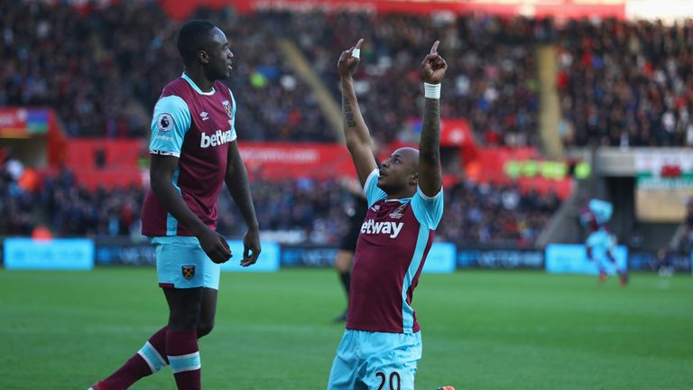 Andre Ayew (right) celebrates scoring his first goal for West Ham with Michail Antonio
