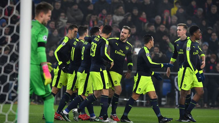Arsenal's players celebrate Perez's first goal