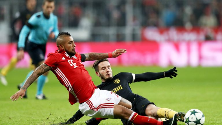 Arturo Vidal slides in for the ball during Bayern Munich's Champions League game at home to Atletico Madrid