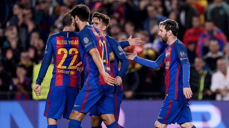 Barcelona forward Lionel Messi (R) is congratulated by his team-mates