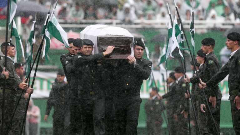 Air Force troops carry the coffin of one of the victims