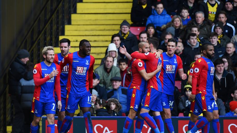 Yohan Cabaye of Crystal Palace celebrates with team-mates  after scoring the opening goal