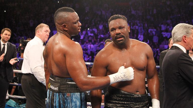 Chisora and Whyte embrace after a terrific battle
