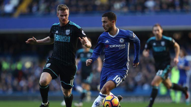Chelsea's Eden Hazard takes on Chris Brunt