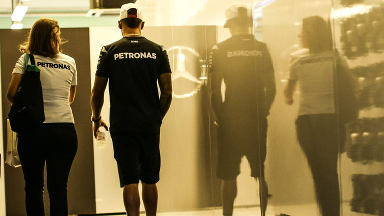 Lewis Hamilton retreats to the Mercedes garage during the Abu Dhabi GP weekend - Picture from Sutton Images