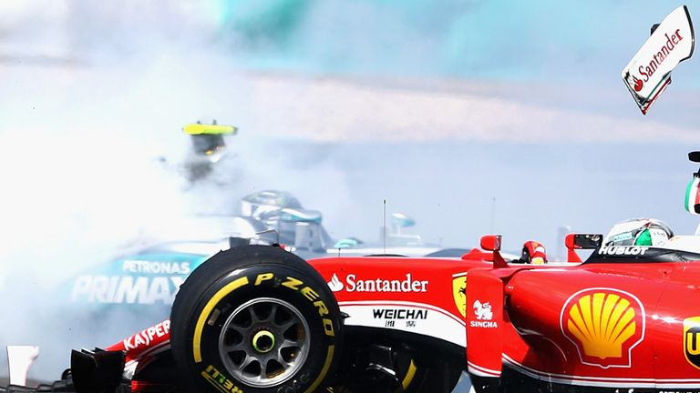 The Ferrari of Sebastian Vettel and Nico Rosberg's Mercedes collide at the start of the Malaysia GP - Picture from Getty Images