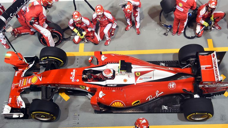 The Ferrari team make a pit-stop during the Singapore GP - Picture from Sutton Images