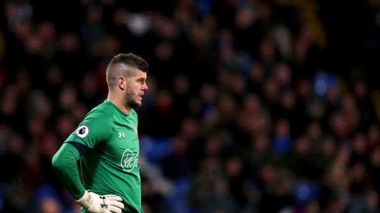 Fraser Forster cuts a disconsolate figure at Selhurst Park