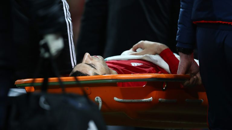 Henrikh Mkhitaryan is stretchered off towards the end of the game