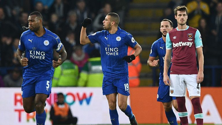Islam Slimani (centre) celebrates scoring Leicester's opening goal