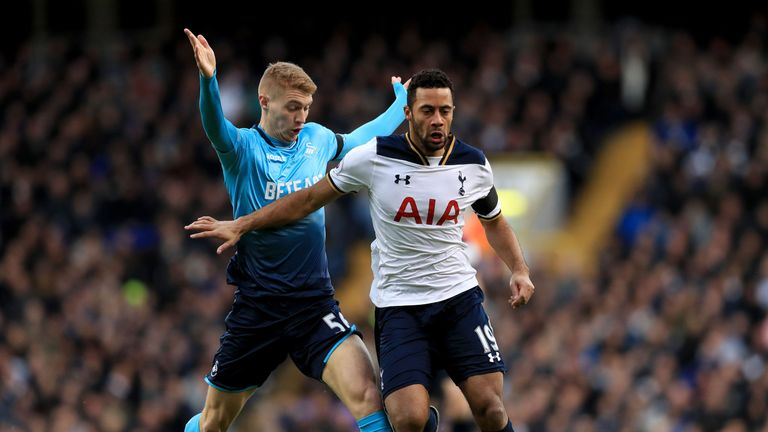Mousa Dembele (right) believes Tottenham can overhual Chelsea and secure the Premier League title this season