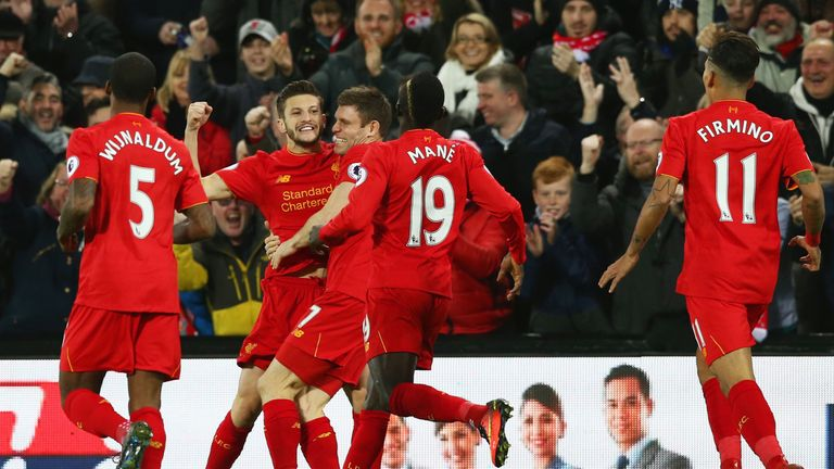 Adam Lallana (second from left) celebrates scoring the opening goal