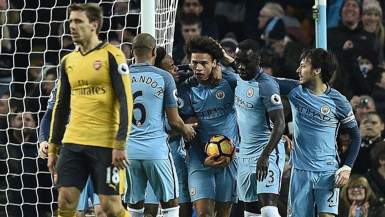 Leroy Sane (C) is congratulated after his first goal for Manchester City drew them level against Arsenal