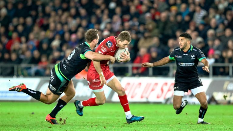 Scarlets' Liam Williams is tackled by Ospreys' Ashley Beck