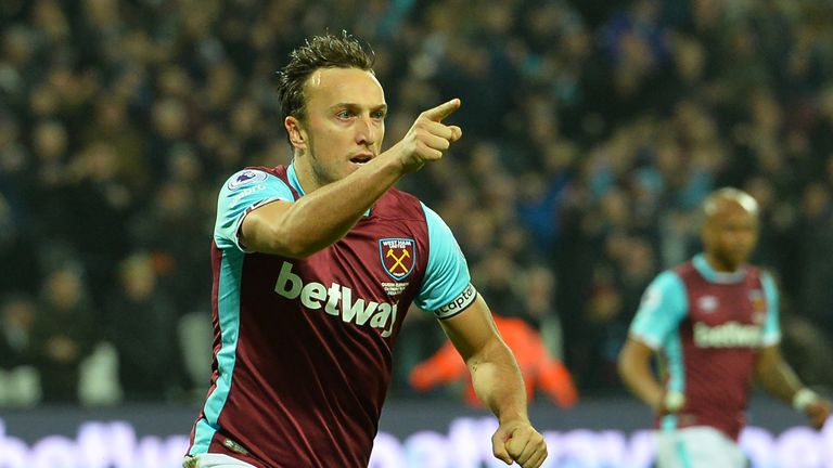 Mark Noble of West Ham United celebrates after scoring a penalty against Hull
