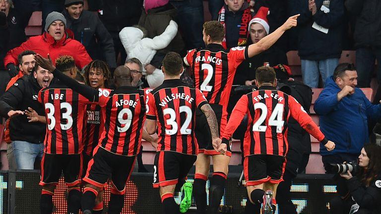 Ake celebrates his winning goal against Liverpool