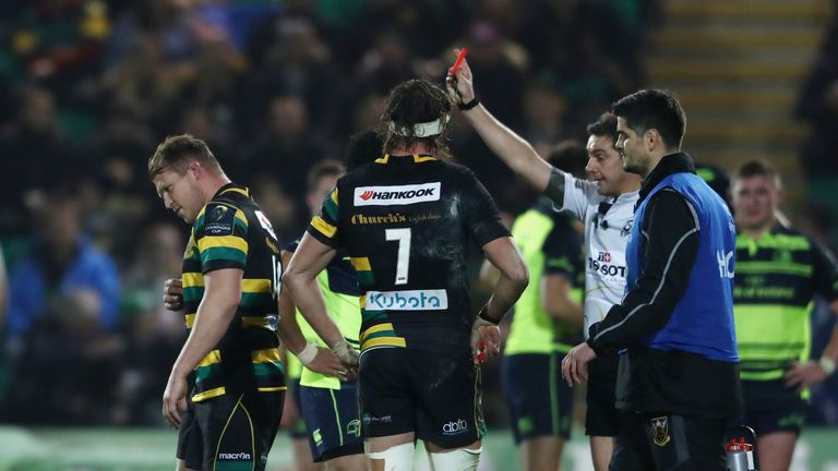 Dylan Hartley walks off the pitch after being shown the red card by referee Jerome Garces for a swinging arm