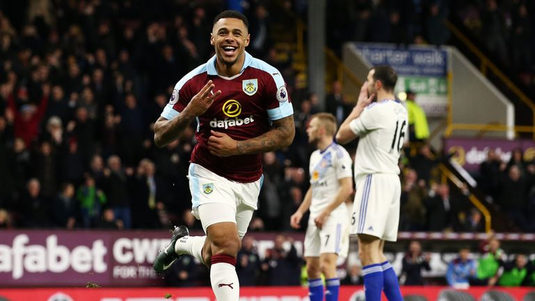 Andre Gray celebrates after netting his and Burnley's third goal of the game