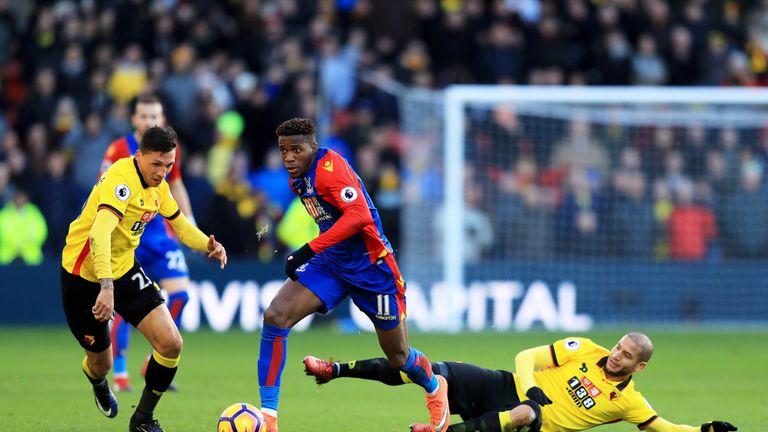 Wilfried Zaha breaks away under pressure from Adlene Guedioura and Jose Holebas