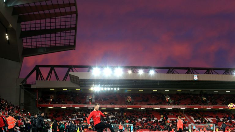 Liverpool players warm up prior to the match