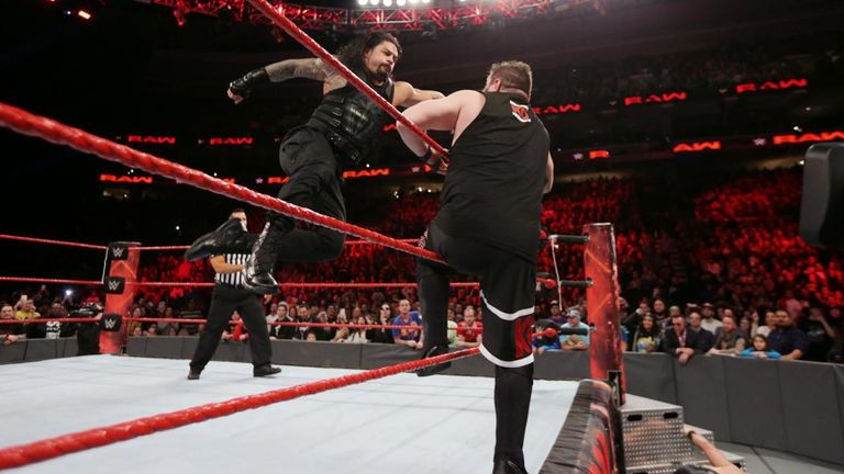 Roman Reigns blasts Kevin Owens with a Superman punch