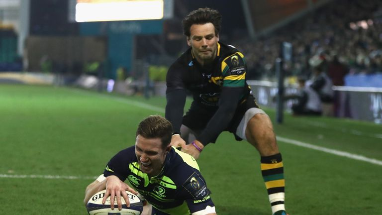 Rory O'Loughlin beats Ben Foden to the high ball to get the third score for Leinster