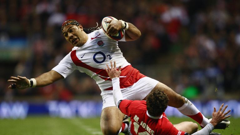 Lesley Vainikolo is tackled by Wales' Mark Jones during his England debut in 2008