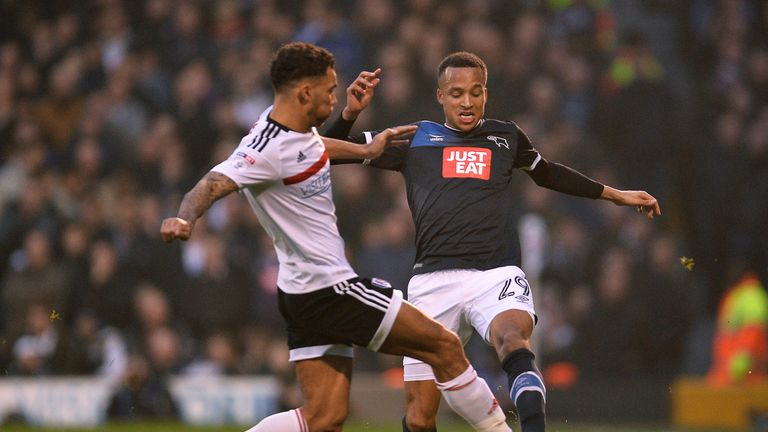 Marcus Olsson of Derby is tackled by Ryan Fredericks