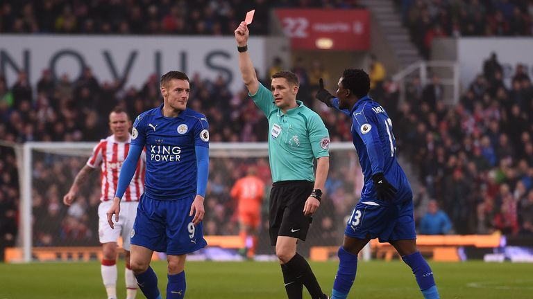 Referee Craig Pawson shows a red card to Leicester striker Jamie Vardy