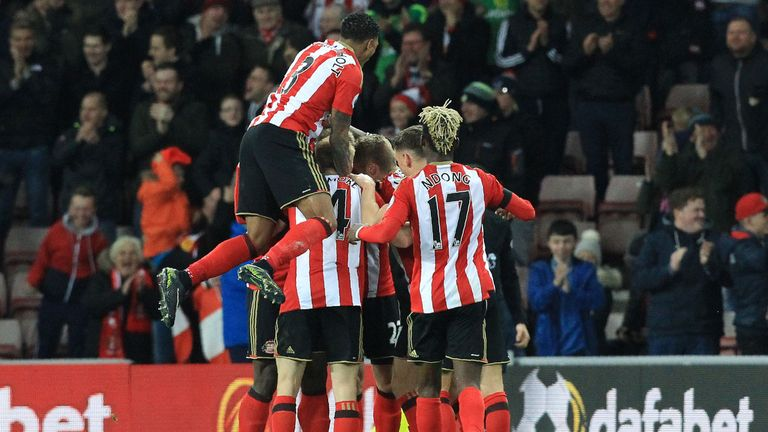 Sunderland players celebrate following Robert Huth's own goal