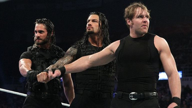 Rollins poses with Roman Reigns and Ambrose during their Shield days